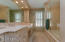 This space has been beautifully updated with elegant vanities, flooring and tub/shower.