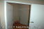 Very large spacious walk in closet in the master suite.