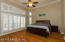 The master suite features teak wood floors & seprate walk-in closets with shelving.