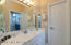 This is a Jack-n-Jill bath located betweenthe second and third bedrooms.