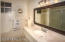Vanity, lighting and mirror makes this bathroom exceptional.