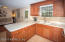 The abundance of cabinets and counter space is impressive.