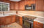 All you could hope for, corian counters, SS appliances, stunning cabinetry, a window!!!