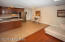 The wood floors, freshly painted walls and baseboards adds charm to this space.