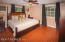 The master bedroom is spacious, boasts wood floors and double windows.