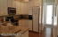 Kitchen, with view of back door that leads to back deck.