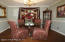 Dining room with tray ceiling, chair rail and crown mouldings