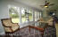 View of Florida room and huge yard with lots of windows and lots of light!