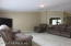Large living room as you enter into the home with new carpet