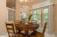 Breakfast nook with slider to Florida room and transom windows that draw in plenty of daylight.