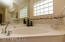 Garden tub, separate shower and dual sinks in large master bath.