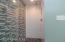 Seamless glass shower door in new guest bath.