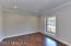 This Room is perfect for many uses - Living Rm, Office, Study... Great Recessed Lighting, Crown Molding & Beautiful Floors highlight this space's chic design style.