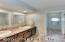 Dual vanities, recessed lighting, new counter-tops, sinks, faucets, backsplash, & more!