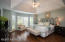 Spacious suite with hardwood floors, tray ceiling and bay window sitting area