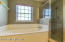Master bath with jetted soaking tub & separate shower
