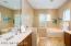 Walk-in shower, soaking tub, double vanities