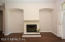 Wood Burning fireplace bracketed by alcoves for TV, Stereo, Etc.