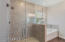 Glass enclosed shower and Garden tub