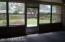 enclosed porch viewing backyard