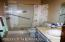 master bath, includes 3 safety bars with 2 in shower and 1 across from commode