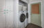 Laundry area mudroom opens to large 2 plus garage