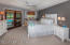 Master Bedroom opens to Sunroom with views of the Pool and Golf Course