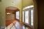 Formal entry way with leaded glass doors, sidelights. Volume ceilings