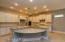 The stunning kitchen features beautiful white cabinetry, an abundance of counter space and huge granite island!