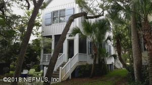 KeyWest style metal roof, wooden working storm shutters. Has not been flooded.