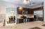 New Backsplash, Solid Countertops, Tile Floors, Stainless Steel Kitchen Aid Appliances.