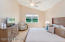 Spacious master bedroom with stunning view to water and preserve