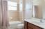 Hall/Guest bath is spacious, also has linen closet close by