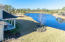 This yard is perfect for a pool! Huge homesite with a peaceful view of the lake