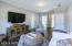 Upstairs game room/tv room is very spacious with hardwood floors & lots of windows!