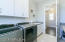 Laundry room has lots of cabinets, folding table and a laundry sink. Perfect for the active family!