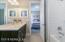 Downstairs en suite guest bath with custom subway tile detail.