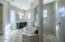 Master bath has a zen-like spa feeling- separate vanities , soaking tub and huge sports style shower