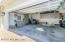 Garage has custom cabinets with Corian counter. Lots of space!