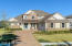 Elegant lake front home with pave red driveway offering ample parking space.