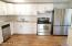 New kitchen cabinets, new stainless steel appliances, new laminate flooring