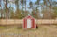 Detached storage shed for lawn equipment