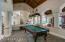 Was original Dining room utilizing 1 large table & at other time 2 large round tables. Is a flex area that can be used several ways such as now with Billiard table.