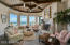 Another Family gathering room featuring the Ocean views, a fireplace, & flat screen T.V.