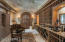 BARREL CEILING, STONE COUNTERS, BUILTIN WINE RACKS, ANTIQUE WOOD CABINET