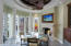 DRAMATIC DOMED WOOD CEILING WITH CEILING FAN, COLUMNS,GRANITE COUNTERS, FLAGSTONE FLOOR