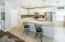 Kitchen has new white kitchen cabinets and decorator back splash.