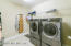 Large Laundry room with ample space for hampers and folding and hanging clothes