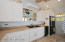 interior of summer kitchen, full size fridge, ice maker, and range
