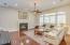 Large Family Room with Cozy Fireplace & Engineered Hardwood Flooring